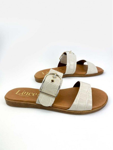 Sandalia plana Lince en piel, plantilla acolchada, modelo 12014, color hueso, vista lateral exterior.