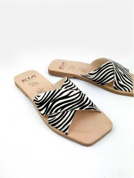 sandalia plana pala cruzada lulu ria menorca, modelo 40418, estampado animal print cebra, piel, punta cuadrada, vista portada